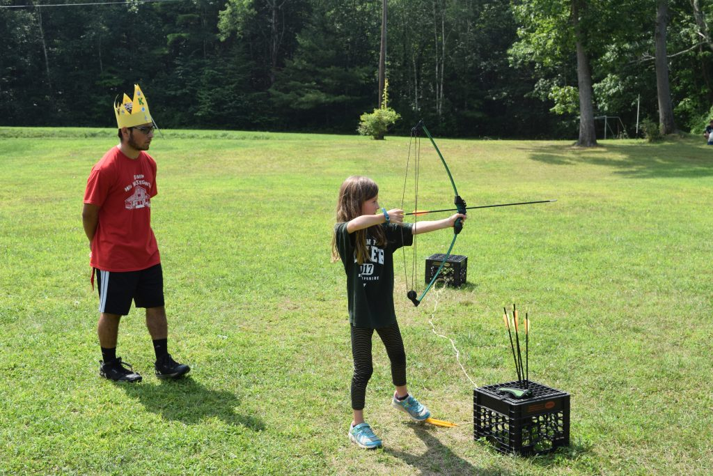 Girl Shooting Bow & Arrow